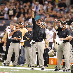 September 9, 2010; New Orleans, LA, USA;  New Orleans Saints defensive backs coach Dennis Allen and defensive coordinator Gregg Williams yell from the sideline during first half of the NFL Kickoff season opener against the Minnesota Vikings at the Louisiana Superdome. Mandatory Credit: Derick E. Hingle