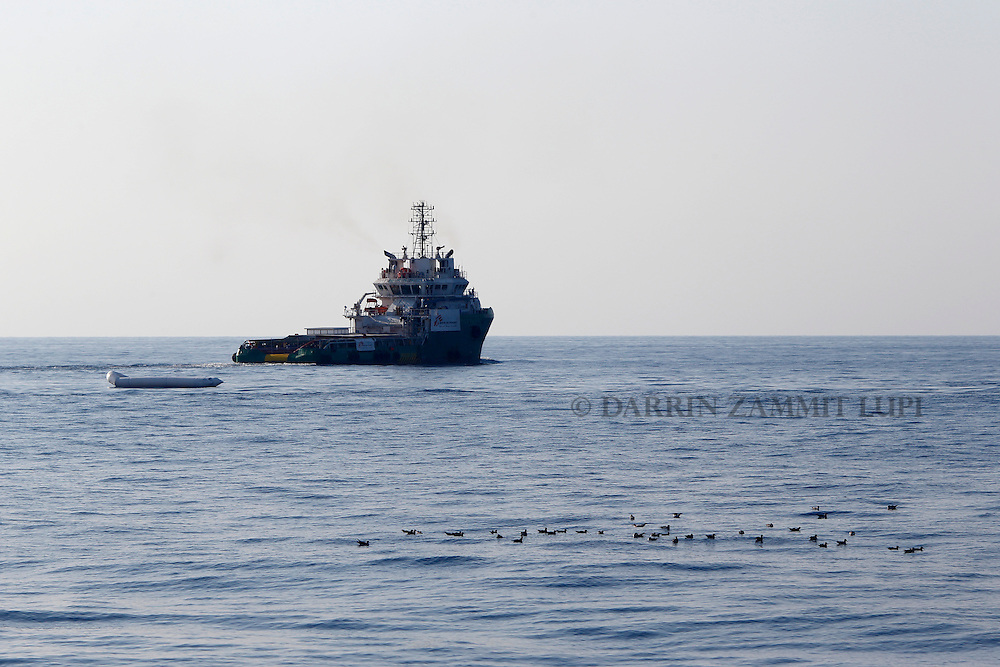 A rubber dinghy drifts abandoned after some 128 migrants were rescued by the Medecins san Frontiere (MSF) ship Bourbon Argos off the coast of Libya August 7, 2015.  <br /> REUTERS/Darrin Zammit Lupi <br /> MALTA OUT. NO COMMERCIAL OR EDITORIAL SALES IN MALTA