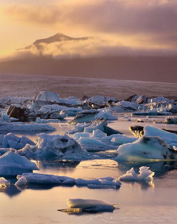 Midnight sun illuminating ice floating in Jökulsarlön, South Iceland, Europe