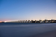 """The Oosterscheldekering DeltaWorks protection barrier at night, Zeeland province. """"One of the Seven Wonders of the Modern World""""."""