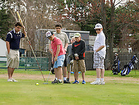 Joel Collins make a putt at Bolduc Park with a group of golfers from Fosters Golf Camp on Friday morning.  (Karen Bobotas/for the Laconia Daily Sun)