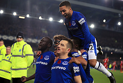 Everton's Leighton Baines (centre, bottom) celebrates scoring his side's third goal of the game from the penalty spot during the Premier League match at Goodison Park, Liverpool.