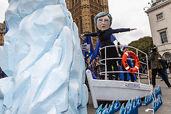 An effigy of Prime Minister Theresa May stands at the prow of the HMS Brexit as it steers towards an iceberg outside Parliament in London on the day MPs vote on Theresa May's Brexit deal. London, January 15 2019.