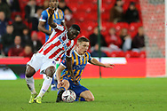 Peter Etebo for Stoke City and 8 Greg Docherty for Shrewsbury Town during the The FA Cup 3rd round replay match between Stoke City and Shrewsbury Town at the Bet365 Stadium, Stoke-on-Trent, England on 15 January 2019.