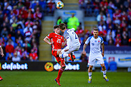 Slovakia defender Peter Pekarik and Wales midfielder Daniel James clash in the air during the UEFA European 2020 Qualifier match between Wales and Slovakia at the Cardiff City Stadium, Cardiff, Wales on 24 March 2019.