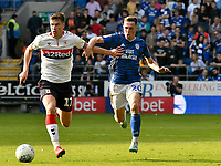 Football - 2019 / 2020 Sky Bet (EFL) Championship - Cardiff City vs. Middlesbrough<br /> <br /> Paddy McNair of Middlesbrough  on the attack Gavin Whyte of Cardiff City defends, at the Cardiff City Stadium.<br /> <br /> COLORSPORT/WINSTON BYNORTH