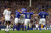 Photo: Greig Cowie.<br /> 23/08/2003.<br /> FA Barclaycard Premiership. Everton v Fulham. Goodison Park.<br /> Everton players celebrate Gary Naysmiths goal as Steed Malbranque hangs his head