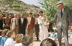 File photo dated 11/10/97 of the Duke of Edinburgh teaching English to Chitrali children at the Aga Khan School in Bilphok, North West Frontier Province in Pakistan. The Duke of Edinburgh has died, Buckingham Palace has announced. Issue date: Friday April 9, 2020.. See PA story DEATH Philip. Photo credit should read: John Stillwell/PA Wire