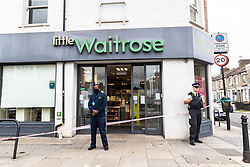 Licensed to London News Pictures. 26/08/202. London, UK. Police guard a Local Waitrose supermarket in Fulham, southwest London this morning after a man was arrested for contaminating food with syringes at three supermarkets last night. Tescos, Sainsbury's and a Waitrose on the Fulham Palace Road in London have been closed with forensic teams checking food stocks. Police have urged anyone who bought food on Wednesday evening at one of the stores to dispose of it as soon as possible. Photo credit: Alex Lentati/LNP