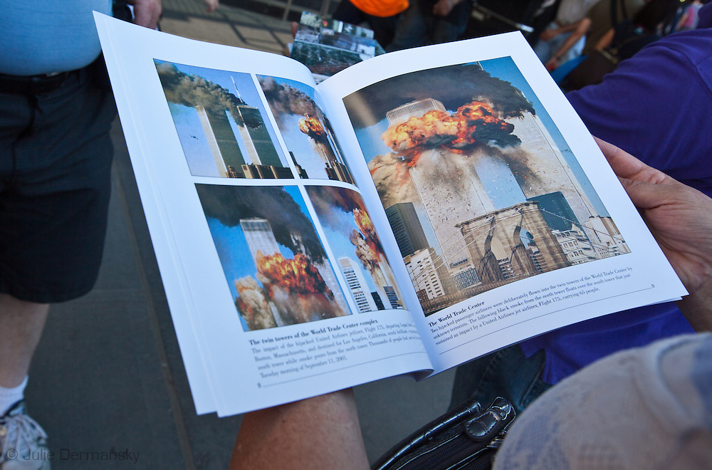 Tourist looking at a book for sale across from Ground Zero illustrated with photos of the World trade Center on fire. New York City prepares to commemorate the 10th anniversary of the 9/11 attacks on the World Trade Center towers despite new credible threats of terrorism.