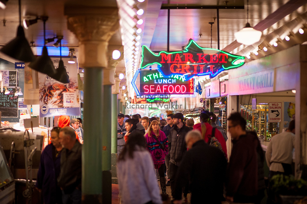2017 DECEMBER 05 - Neon signs and people at Pike Place Market, Seattle, WA, USA. By Richard Walker