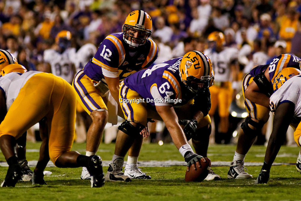 October 16, 2010; Baton Rouge, LA, USA; LSU Tigers quarterback Jarrett Lee (12) under center during a game against the McNeese State Cowboys at Tiger Stadium. LSU defeated McNeese State 32-10. Mandatory Credit: Derick E. Hingle