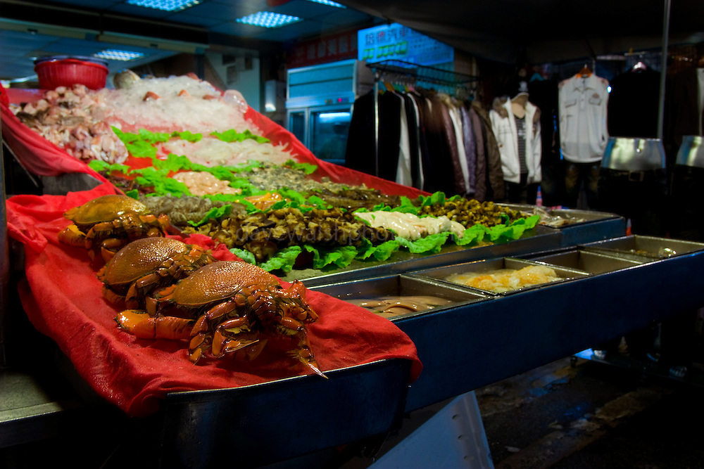 Crabs and clothes, in the Miaokou Night Market, Keelung, Taiwan
