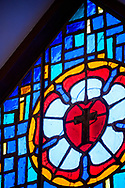 Stained glass depicting the Luther seal on Tuesday, Aug. 24, 2021, at Grace Lutheran Church, Summerville, S.C. LCMS Communications/Erik M. Lunsford