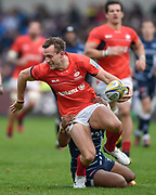 Saracens full-back Andrew Fenby is held by Sale Sharks wing Paolo Odogwu during the Aviva Premiership match Sale Sharks -V- Saracens at The AJ Bell Stadium, Salford, Greater Manchester, England on November  20  2016. (Steve Flynn/IOS via AP)