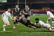 Dan Evans of the Ospreys © dives over to score his 1st try in the 2nd half. European Rugby Champions Cup, pool 2 match, Ospreys v ASM Clermont Auvergne at the Liberty Stadium in Swansea, South Wales on Sunday 15th October 2017.<br /> pic by  Andrew Orchard, Andrew Orchard sports photography.