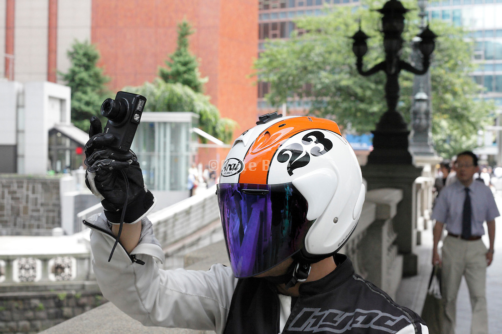 taking a snap while wearing a dark tinted visor on helmet