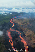 Aerial view of lava river erupted from Fissure 8 of the Kilauea Volcano east rift zone, near the town of Pahoa. The lava drains downhill as an incandescent river to Kapoho, Puna District, Hawaii Island ( the Big Island ), Hawaiian Islands, U.S.A.