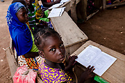 Ghana has made giant strides in extending basic education in numeracy and literacy over the past decade to the vast majority of the population. But many poor children (particularly girls) and those in rural areas are still left out, with around 650,000 children currently out-of-school. Recognizing this, the Ghana government has prioritized the roll out of education for excluded children – known as complementary basic education (CBE). Over a period of just nine months, children aged 8-14 who are not in school are taught basic literacy, numeracy and life skills in their mother tongue using accelerated literacy strategies contextualized to their community. They are then ready to join primary school for the first time.<br /> CBE has been delivered by NGO's in Ghana, funded by donor agencies. DFID and UNICEF have been key players through its support for School for Life, an NGO that has achieved remarkable results with CBE. School for Life has been operational in northern Ghana since 1995 and has helped over 140,000 children attain basic literacy and numeracy skills.Since 2008, DFID has given 12,000 out-of-school children literacy and numeracy skills; 80 per cent of these have joined the formal school system and 480 teachers are now trained to use the programme's innovative pedagogy. The new project will build on this success to coordinate a nationwide programming.As Ghana works towards the UN Millennium Development Goals set for 2015, the roll out of this CBE programme will help move the country closer to meeting MDG 2 (universal primary education) and MDG 3 (gender equality). It will also provide a model for other African Countries to emulate in order to reach the last 5-10% of out of school children.<br /> <br /> Photos: Francis Kokoroko / @accraphoto 2017<br /> <br /> Text: Crown Agents