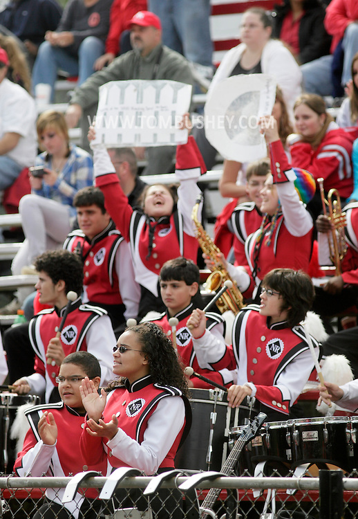 Thiells, New York - Members of the North Rockland High School Marching Band cheer for their team in the bleachers during a football game against Ramapo on Sept. 26, 2009.