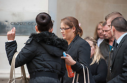 © Licensed to London News Pictures. 07/10/2015. Bristol, UK.  The family of Rebecca Watts, outside court at the start of the trial for the murder of Rebecca Watts at Bristol Crown Court.  Photo credit : Simon Chapman/LNP