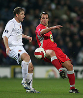 Photo: Paul Thomas.<br /> Blackburn Rovers v Basle. UEFA Cup. 02/11/2006.<br /> <br /> Blackburn's Lucas Neill (R) passes it past Scott Chipperfield.