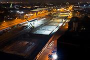 Tunnelschacht Rotterdamsebaan op de Binckhorstlaan bij nacht vanaf het Teleport hotel