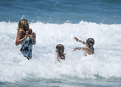 June 15, 2017 - Los Angeles, California, U.S - People enjoy the cold ocean water  in Hermosa Beach, California, Thursday June 15, 2017. Temperatures are expected to climb 12 to 18 degrees above normal this weekend through at least the middle of next week, according to the National Weather Service. (Credit Image: © Ringo Chiu via ZUMA Wire)