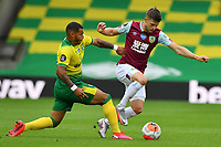 Football - 2019 / 2020 Premier League - Norwich City vs. Burnley<br /> <br /> Burnley's Jóhann Gudmundsson holds off the challenge from Norwich City's Onel Hernandez, at Carrow Road.<br /> <br /> COLORSPORT/ASHLEY WESTERN