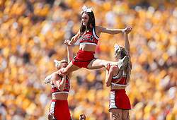 Sep 14, 2019; Morgantown, WV, USA; North Carolina State Wolfpack cheerleaders perform during the third quarter against the West Virginia Mountaineers at Mountaineer Field at Milan Puskar Stadium. Mandatory Credit: Ben Queen-USA TODAY Sports