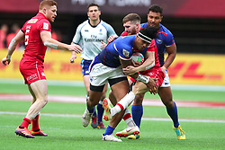 March 9, 2019 - Vancouver, BC, U.S. - VANCOUVER, BC - MARCH 09:  Tofatu Solia (1)  of Samoa attempts to avoid being tackled by Isaac Kaay (8) of Canada during day 1 of the 2019 Canada Sevens Rugby Tournament on March 9, 2019 at BC Place in Vancouver, British Columbia, Canada. (Photo by Devin Manky/Icon Sportswire) (Credit Image: © Devin Manky/Icon SMI via ZUMA Press)