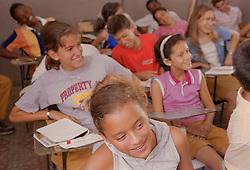 Secondary school children sitting at desks in classroom,