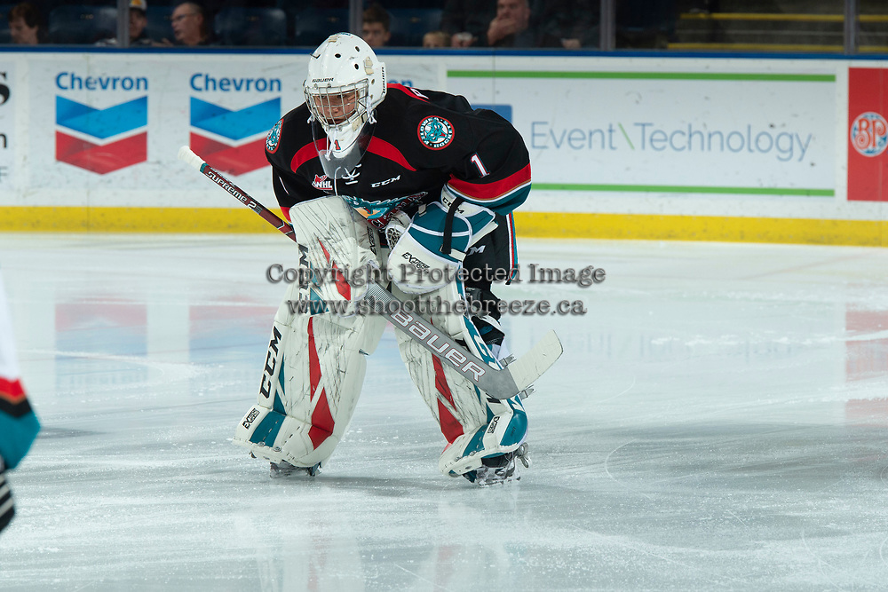 KELOWNA, CANADA - DECEMBER 5:  James Porter #1 of the Kelowna Rockets skates to the blue line for the national anthem against the Tri-City Americans on December 5, 2018 at Prospera Place in Kelowna, British Columbia, Canada.  (Photo by Marissa Baecker/Shoot the Breeze)