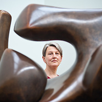 London, UK - 13 May 2013: Penelope Curtis, director at Tate Britain poses for a picture next to a sculpture by Henry Moore. .The new chronological presentation of the world's greatest collection of British art will allow visitors to experience the national collection of British art in a continuous chronological display from the 1500s to the present day.
