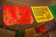 New York, NY, October 31, 2013. Traditional paper cutout banners, called papel picado, hang from the tent.