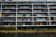 Regents Canal in East London. This canal cuts all the way up through and across east and north London providing a natural yet industrial refuge for those that use it for leisure or living. Many small apartment buildings now line the canal.