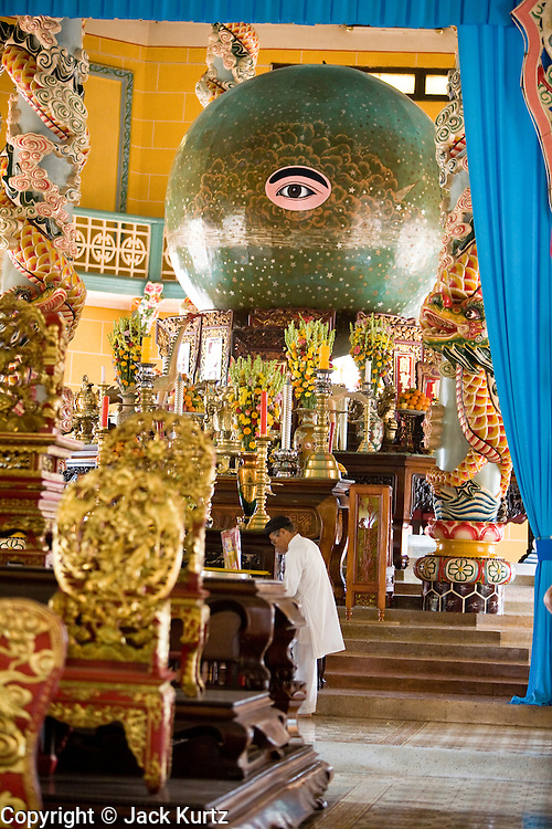 """10 MARCH 2006 - TAY NINH, VIETNAM: Interior of the main Cao Dai Temple in Tay Ninh. The Cao Dai complex in Tay Ninh is the sect's headquarters. The Cao Dai religion is a blending of Buddhism, Confucianism, Taoism, Christianity and Islam. There """"saints""""  include Chinese leader Sun Yat Sen and French author Victor Hugo. There are about two million members of the Cao Dai religion in Vietnam. British author Graham Greene, who wrote about the Cao Dai in the """"The Quiet American"""" said the relegion was """"a Walt Disney fantasia of the East."""" Photo by Jack Kurtz / ZUMA Press"""