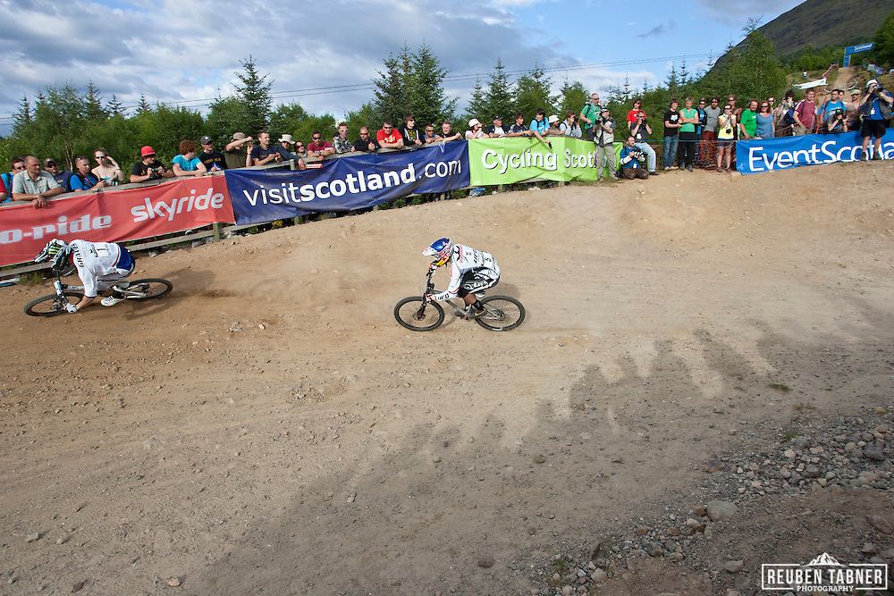 Jared Graves (AUS) and Michal Prokop (CZE) battle it out in the semi-final of the men's four cross at the UCI Mountain Bike World Cup in Fort William, Scotland.