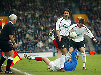 Photo: Scott Heavey.<br /> Portsmouth v Liverpool. FA Cup 5th Round replay. 22/02/2004.<br /> Milan Baros screams a t the linesman as his tangles with Matthew Taylor
