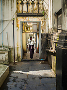 01 NOVEMBER 2014 - YANGON, MYANMAR: A man walks through the grounds of the Mogul Mosque (also called a Masjid in Southeast Asia) in Yangon. Mogul Mosque is a Shia Mosque established in 1854. The current building was constructed in 1918.     PHOTO BY JACK KURTZ