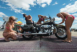 Aianna Buist, Erinn Mahony, Juleesa Davila and Melissa Stevens in the Bikini Bike Wash at the Buffalo Chip on the final Saturday of the annual Sturgis Black Hills Motorcycle Rally. SD, USA. August 13, 2016. Photography ©2016 Michael Lichter.