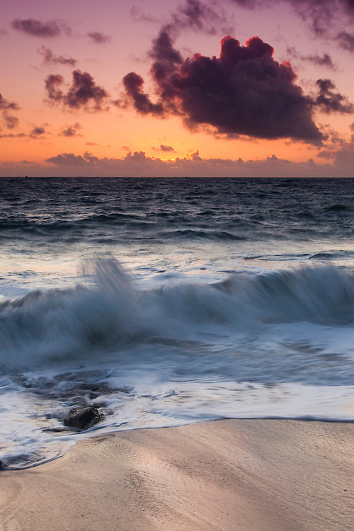 northern california sunset with a long exposure to soften the crashing surf.