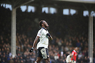 Fulham striker, Moussa Dembele (25) after a miss during the Sky Bet Championship match between Fulham and Charlton Athletic at Craven Cottage, London, England on 20 February 2016. Photo by Matthew Redman.