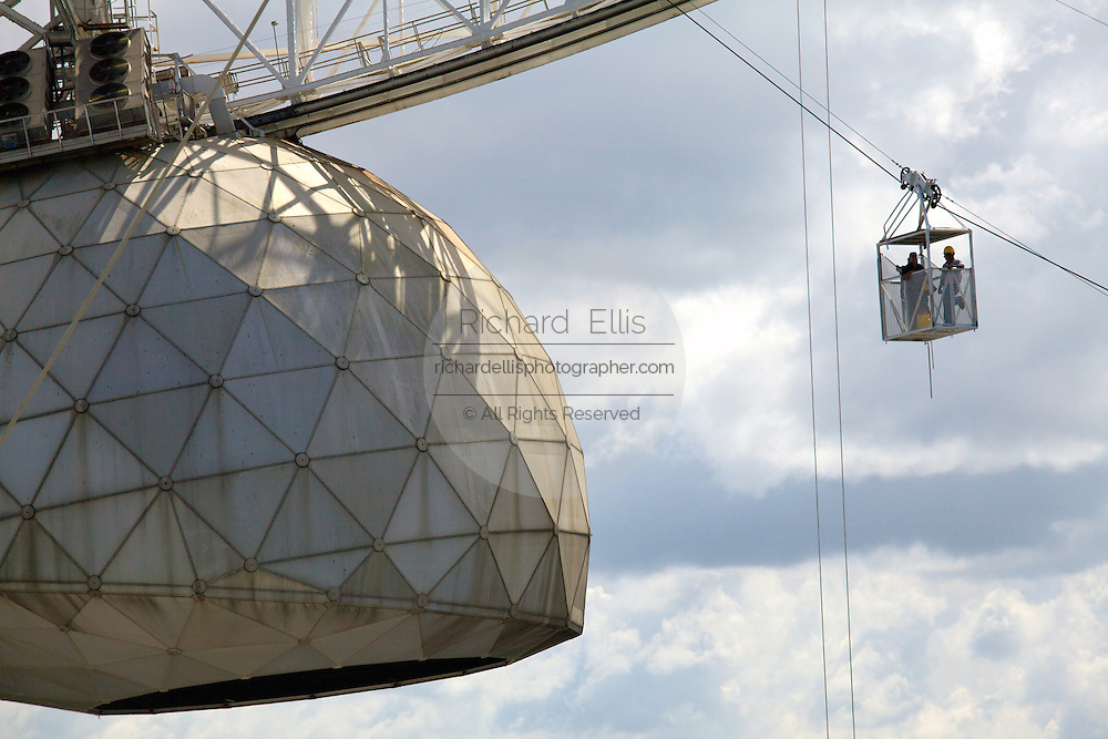 Workers at the National Astronomy and Ionosphere Center Arecibo Observatory take the cable car to the receiver at the center of the telescope February 20, 2013 in Arecibo, Puerto Rico. Arecibo Observatory is home to the largest radio telescope on Earth.