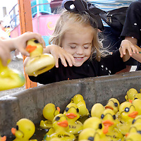 Ready to grab duck Haley Plowman, 2, of Santa Fe closes her eyes to pick a duck at the Galveston County Fair at Jack Brooks Park, 04/22/04. (Photo by Kim Christensen)