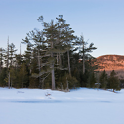 Early morning on one of the ponds at Little Lyford Pond Camps near Greenville, Maine, Winter.  Indian Mountain is in the distance.