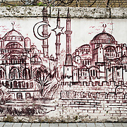 A painting of two of Istanbul's famous mosques on a wall in Istanbul's Eminonu quarter.