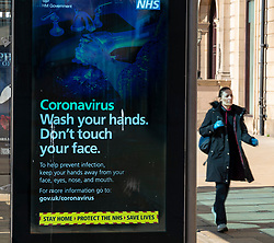 Edinburgh, Scotland, UK. 8 April 2020. Images from Edinburgh during the continuing Coronavirus lockdown. Pictured; Video screen with Coronavirus health warning and advice.  Iain Masterton/Alamy Live News.