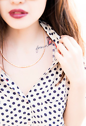 Young Woman Showing her Chest Tattoo, Cropped View