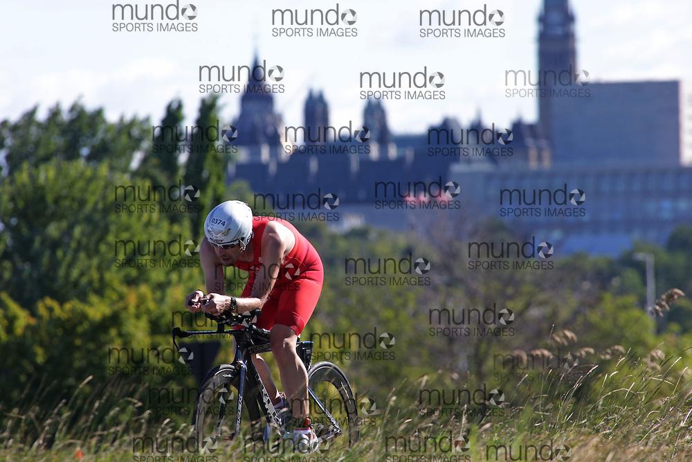 (Ottawa, Canada---10 August 2013)  Rodney Buike (374)  of Canada (CAN) competing in the 40-44 Male AG International Triathlon Union 2013 World Duathlon Championships (10 km run- 40 km bike- 5km run).